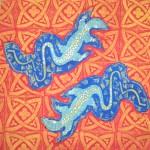 Orange Goanna cushions - linoblock print