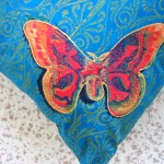 Turquoise Butterfly cushions detail -  linoblock print