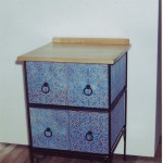 Fabric stretched chest of drawers made by Andrew Halford